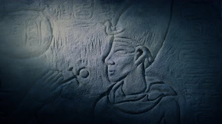 Egyptian Wall Art Lit Up In Dusty Tomb Stok Video