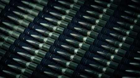 hajtások : Machine Gun Bullets Rotating Closeup Stock mozgókép