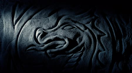 Torch Lights Up Dragon Carving On Cave Wall