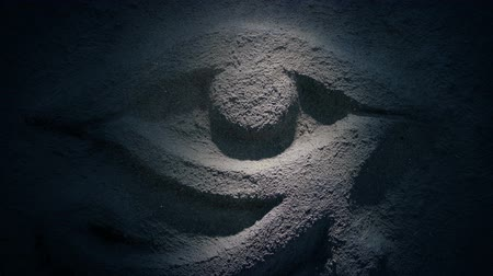 Light Shines On Ancient Stone Eye Carving