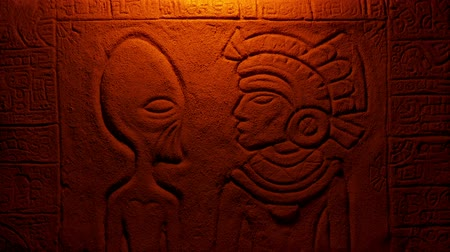 azték : Fire Lights Alien And Aztec Man In Wall Carving Stock mozgókép