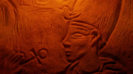 relics : Egyptian Rock Carving Of Man In Firelight Stock Footage