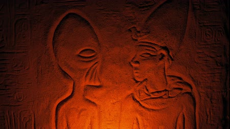 egyiptomi : Ancient Alien Wall Carving Lit Up Inside Tomb