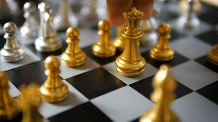 rytíř : Close up shot hand of man and woman play gold and silver chess metaphor business compettition concept select focus shallow depth of field