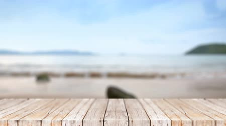 デッキ : 4K Wood floor against blur nature sea beach abstract background
