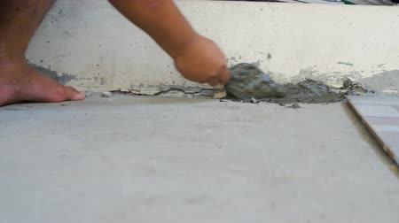 4K Hands of man using trowel and mortar to diy fix cement concrete