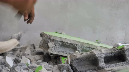 marreta : Worker using hammer hit concrete for break it to be small fractal construction concept