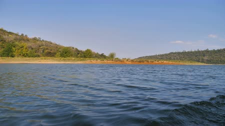 canoa : Boat view sailing and moving in the big river with nature tropical forest and mountain