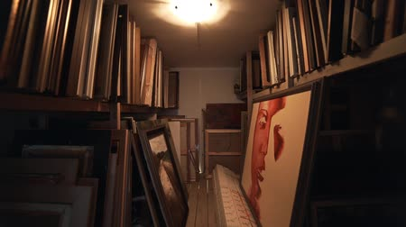 Warehouse of pictures in the artists creative workshop, frames and linens, pantry with shelves, storages