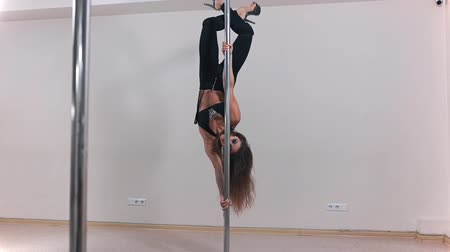 Beautiful sexy white pole dancer, woman is dancing near the pole, erotic dancing, choreography and sport, pole dancing Stok Video
