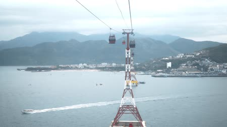 brazil : Great view of the mountains from cabin of cableway above the sea, funicular above the water, aerial view of the coast, transport