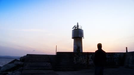 Man walking from lighthouse. Full HD 1080p, 24fps, Selective focus.