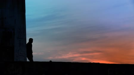 Thoughtful man standing towards sunsetsunrise. Full HD 1080p, 24fps, Selective focus.