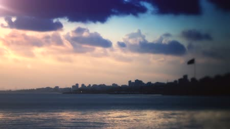 Sunset over coastal cityscape. Full HD, 1080p, 24fps, Selecive focus.