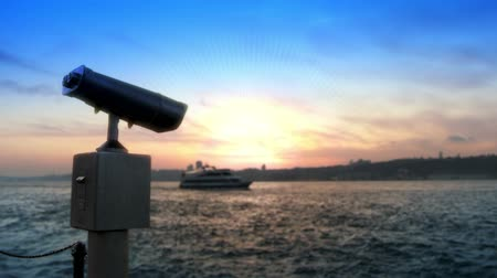 Coin operated binocular near cityscape. Full HD, 1080p, 24fps, Selecive focus.