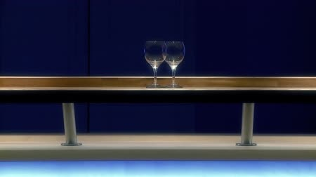 Moving glass on wooden bar. Full HD, 1080p, 1920x1080.