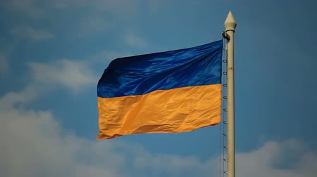 Украина : Flag of Ukraine  against the background of cloudy sky. Flags of the world collection, Ukraine.