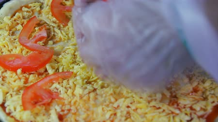 slicer : The chef puts diced tomatoes on a blank pizza Stock Footage