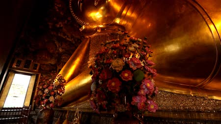 wat pho : The Big golden Reclining Buddha within Wat Pho is the important in Bangkok, Thailand.