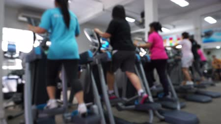 kişi : Group of  blurred young people running on treadmill in gym
