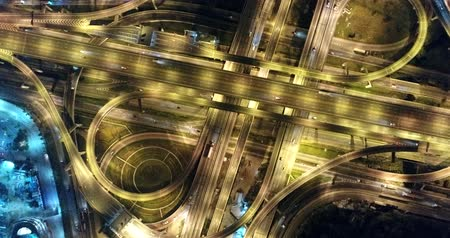 bird's eye view : Night aerial interchang road traffice with car light Stock Footage