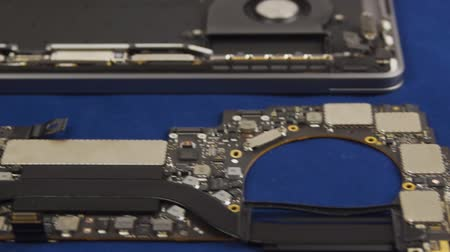hdd : Disassembled laptop. Laptop motherboard next to the case, tools and tester. Close-up Stock Footage