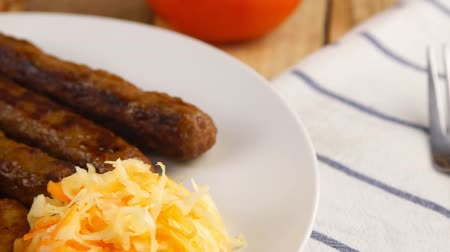 sérvia : Serbian cevapi, cevapcici, Balkan minced meat kebab on a white plate with marinated cabbage Vídeos