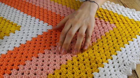 Needlework. The master by hand checks the quality of the colorful crocheted woolen bedspread. Stockvideo