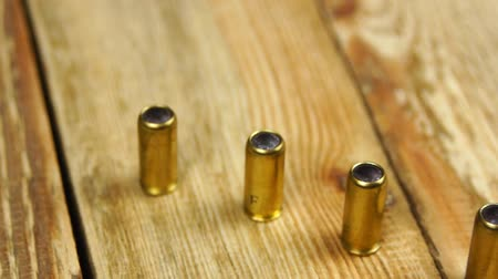 sorok : Ammunition with rubber bullets next to traumatic pistol on a wooden background