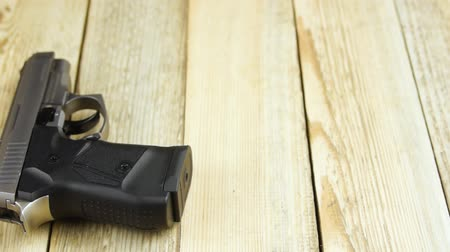 traumatic : Traumatic pistol lies on a wooden background. Close-up