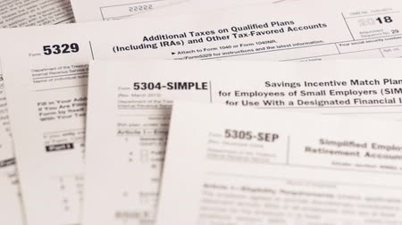 belasting invullen : Tax forms 5329, 5304-simple, 5305-ser and personal plan 401k . Close-up