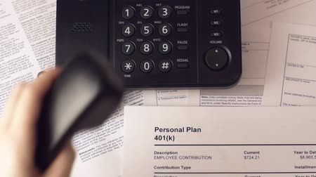 belasting invullen : Woman phoning to find out about retirement banking plan 401k. Stockvideo