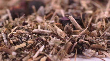 kamilla : Herbal collection for the preparation of a tonic drink. Dry herbal mass rotates from left to right. Macro video. Close-up