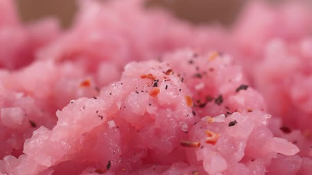 Minced meat close-up. Shown the process of additions spices in minced meat. Macro video