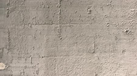 бежевый : Vertical panorama of textured concrete pavement. Moving the camera from top to bottom. Close-up