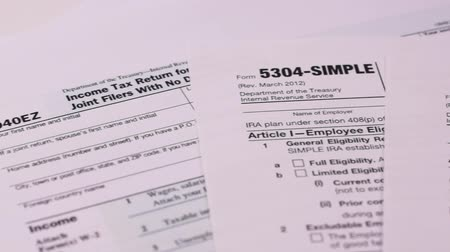 Tax forms 5304-simple, 5305-ser and 1040ez . Close-up Wideo