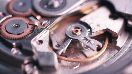 Vintage mechanical watch inside. Functioning mechanism of the clock, the movement of the pendulum. Macro video