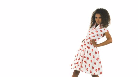 pinup : Young cute african girl posing in studio. Fashion african young model in pin up style in studio. Stock Footage