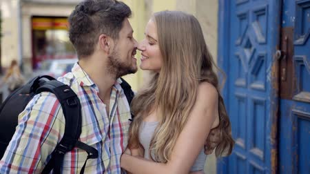 casal heterossexual : Couple kissing - happiness fun date. Young attractive couple embracing and laughing on date. Caucasian couple on holidays.