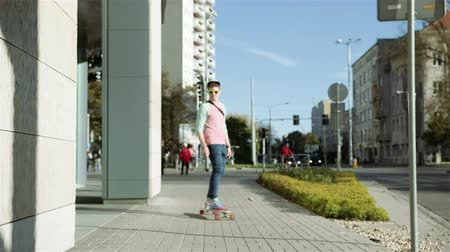 longboarder : Young cheerful man on longboard in the city streets. Stock Footage