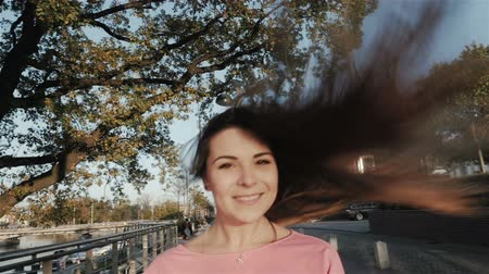 długie włosy : Happy woman with beautiful hair in the city, slow motion, shot at 96fps Wideo