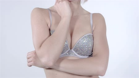 bra : Cheerful blonde girl with fringe wearing diamond bra over white background. Wideo