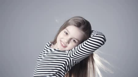 cabelos grisalhos : Portrait of beautiful child model girl with long hair looking at camera. Vídeos