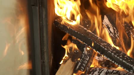 pan : Fire in the fireplace, pan, close up, slow motion