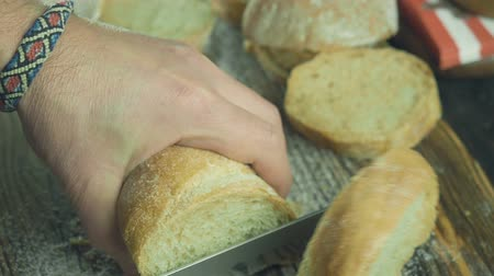 slicer : Cut slice of bread in slow motion, close up Stock Footage