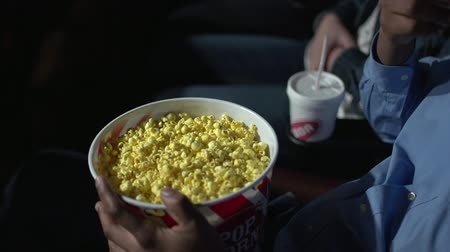 дата : a view of eating popcorn at the movies