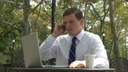 ethic : A young business man engages in a stressful conversation on his cell.