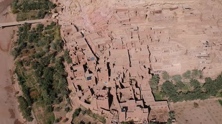 dune : Flying near Ait-Ben-Haddou at Morocco with Drone - Ait-Ben-Haddou from above Stock Footage
