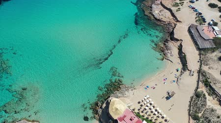 Flying with drone over beautiful natural beach in Ibiza Stockvideo