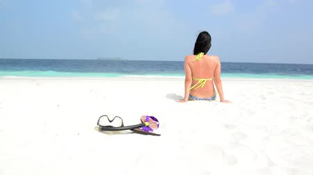 Мальдивы : Woman is relaxing at tropical beach, South Male Atoll. Maldives
